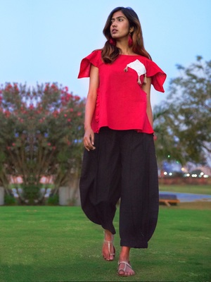 Red Top And Black Baggy Pants Pair