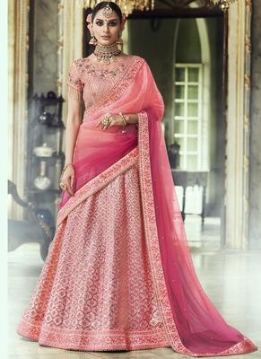 Pink thread embroidery net semi stitched lehenga