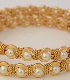 Gold pearl bangles