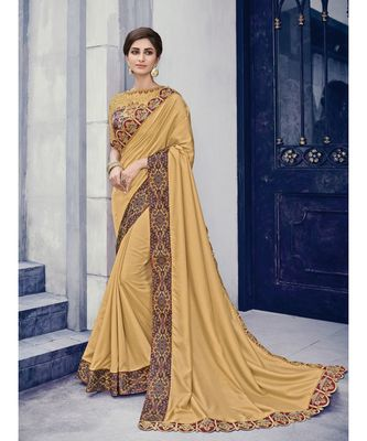 golden embroidered silk blend saree with blouse