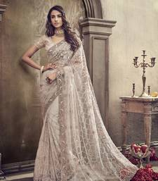 Ivory embroidered net saree with blouse