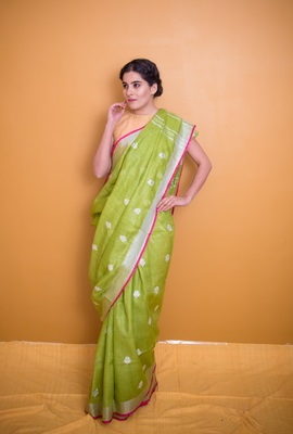 Light Leafy Green Saree With Pink Pom Poms In Khadi Linen