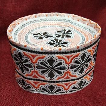 Black and orange embroidered prayer cap