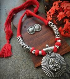 Ganpati pendant red tassle necklace with matching Ganpati earings in German Silver