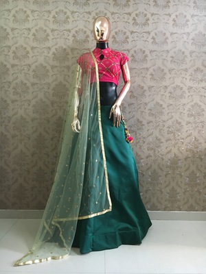Green plain satin semi stitched lehenga