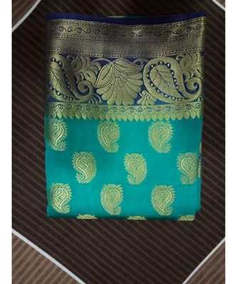green paisley motif kanchipuram saree with blouse