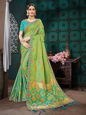 Green embroidered Banarasi Silk saree with blouse
