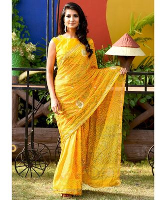 Beautiful yellow bandhej saree with blouse