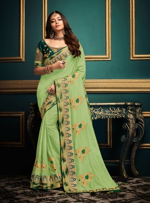 Light green embroidered satin saree with blouse