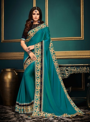 Light teal embroidered satin saree with blouse