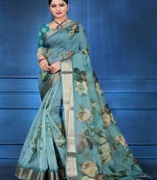aqua blue printed organza saree with blouse