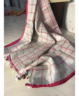 Check Tissue linen handwoven saree with contrast border and blouse piece