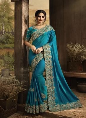 light blue embroidered silk blend saree with blouse