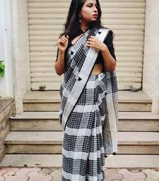 Black woven handloom linen saree with blouse