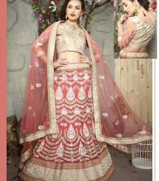 Peach embroidered net semi stitched lehenga