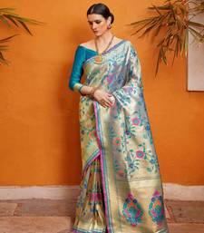 light blue woven silk blend saree with blouse