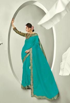 Dark sea green embroidered pure chiffon saree with blouse