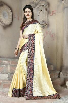 Cream plain paper cotton saree with blouse