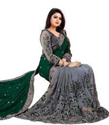 Dark green embroidered silk & net  saree with blouse