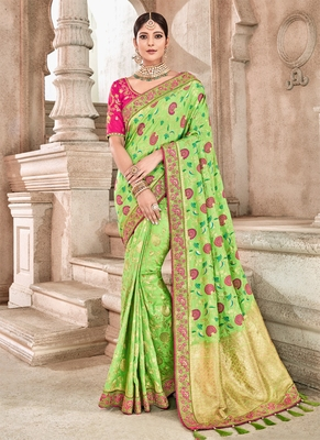 Cyan embroidered silk saree with blouse