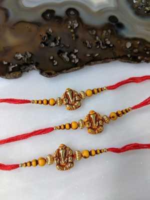 Set Of 3 Ganesh Ji Designer Gold Yellow Bead Multicolor Thread Rakhi For Brother