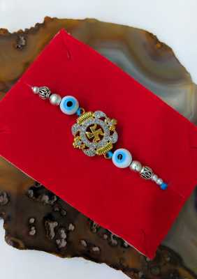 Gold Swastik Designer with Evil Eye Silver Beads Blue Thread Rakhi For brother