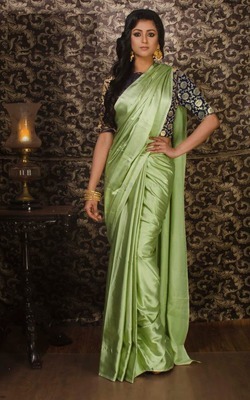 Light parrot green plain silk saree with blouse