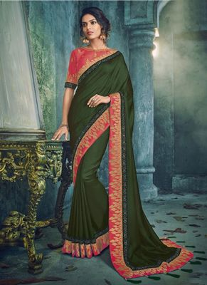 Dark green woven silk saree with blouse