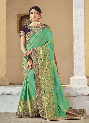 sea green embroidered cotton silk blend saree with blouse