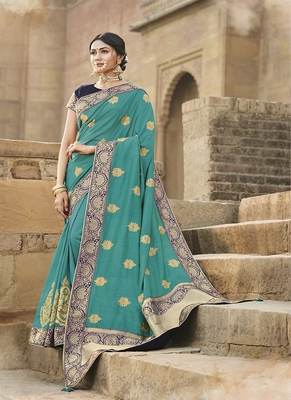 turquoise embroidered cotton silk blend saree with blouse