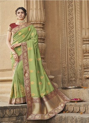 light green embroidered cotton silk blend saree with blouse