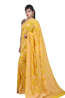 Yellow hand woven pure chiffon saree with blouse