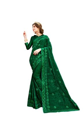 Dark green embroidered chiffon saree with blouse