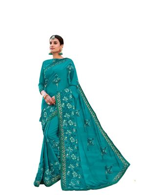 Turquoise embroidered georgette saree with blouse