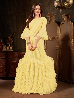 Yellow plain georgette ruffle saree with blouse