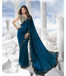 Teal plain art silk saree with blouse