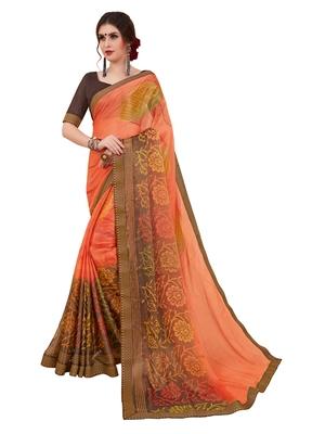 Orange printed brasso saree with blouse