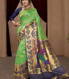 Buy green woven silk blend saree with blouse