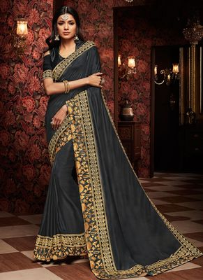 Dark grey embroidered silk saree with blouse