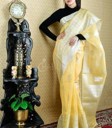 YELLOW BLENDED TISSUE SAREE WITH SILVER THREAD WORK