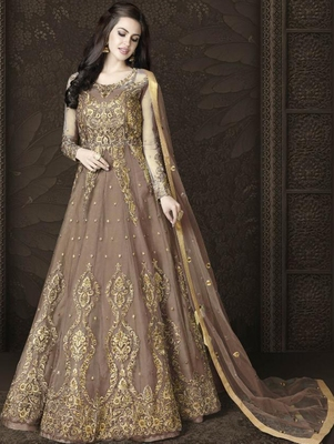 Light Brown Butterfly Net Heavy Embroidery And Diamonds Designer Suit