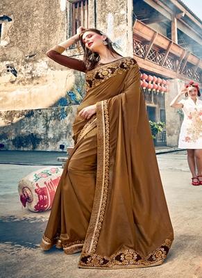 dark beige embroidered georgette saree with blouse