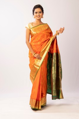 Orange hand woven silk blend saree with blouse