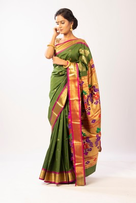 Green hand woven silk blend saree with blouse