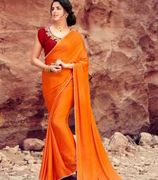 orange plain satin saree with blouse