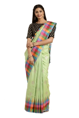 Light green woven katan silk saree with blouse