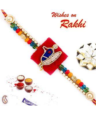 Zardosi work Peacock Rakhi with Golden Beads