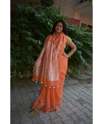 orange Soft linen saree with tassel in the pallu and running blouse