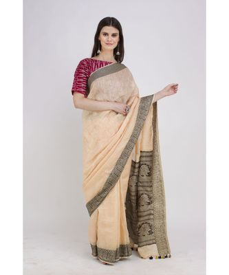 peach Soft linen saree with tassel in the pallu and running blouse