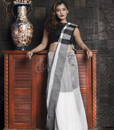 White plain blended cotton saree with blouse